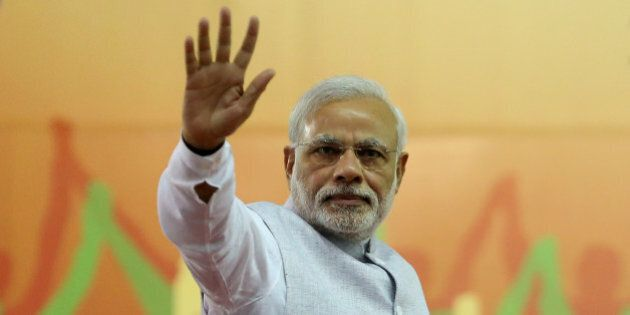 India's Prime Minister Narendra Modi waves to his supporters after addressing a rally organized by his...