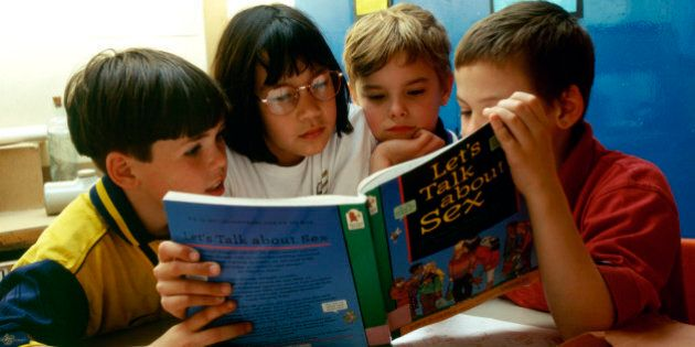 Sex education in primary school. 8 & 9 year olds reading Let's Talk About Sex book, London Borough of Greenwich UK. (Photo by: Photofusion/UIG via Getty Images)