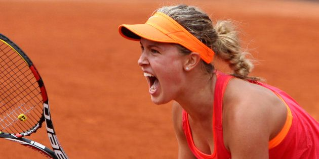 Canada's Eugenie Bouchard reacts as she defeats Spain's Carla Suarez Navarro during their quarterfinal...