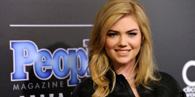 Kate Upton arrives at The People Magazine Awards at the Beverly Hilton hotel on Thursday, Dec. 18, 2014, in Beverly Hills, Calif. (Photo by Chris Pizzello/Invision/AP)