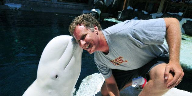 SAN DIEGO, CA - JULY 19: In this handout photo provided by SeaWorld San Diego, actor Will Ferrell gets...