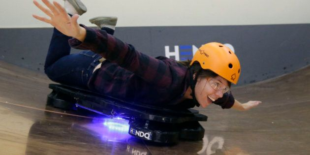 In this Oct. 30, 2014 photo, Arx Pax engineer Shauna Moran demonstrates riding a Hendo Hoverboard in...