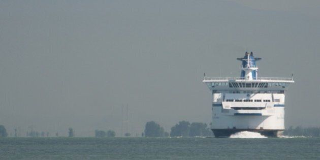 One of BC Ferry's marvelous car and passenger ferries emerges from the late-morning haze on a run out...