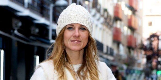 MADRID, SPAIN - DECEMBER 17: Marta wearing Massimo Dutti boots, Fun & Basics handbag and Zara sweater...