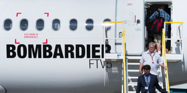 Attendees exit the new Bombardier Inc. CS100 airplane during an event at the company's facility in Toronto,...