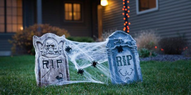 USA, Illinois, Metamora, Halloween gravestone decoration on lawn