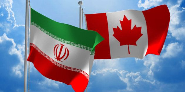 Flags from Iran and Canada flying side by side for important