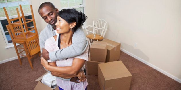 Moving house. African American mid adult couple (30s) moving into new