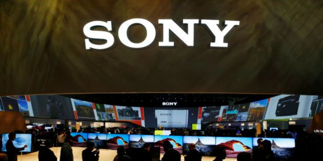 People crowd around the Sony booth during the International CES Tuesday, Jan. 6, 2015, in Las Vegas....