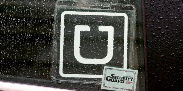 The Uber Technologies Inc. logo is displayed on the window of a vehicle after dropping off a passenger...