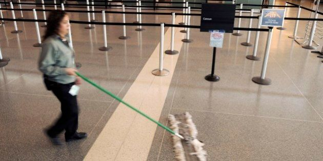 A janitor sweeps near the empty ATA Airlines ticket counter at Chicago's Midway International Airport...