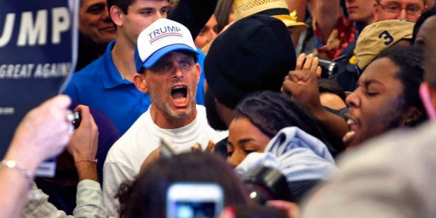 A supporter of Republican presidential candidate Donald Trump yells at protestors who were