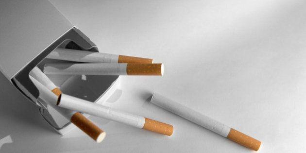 selective focus image of cigarettes against plain
