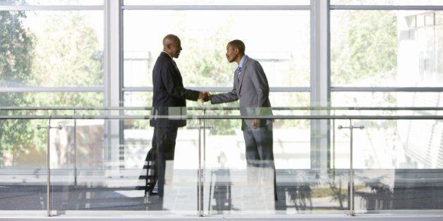 Business men shaking hands, Johannesburg, Gauteng, South