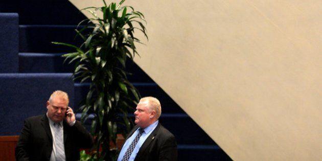 TORONTO, ON - NOVEMBER 15 - Toronto City Councillor Doug Ford stands with his brother Toronto Mayor Rob...