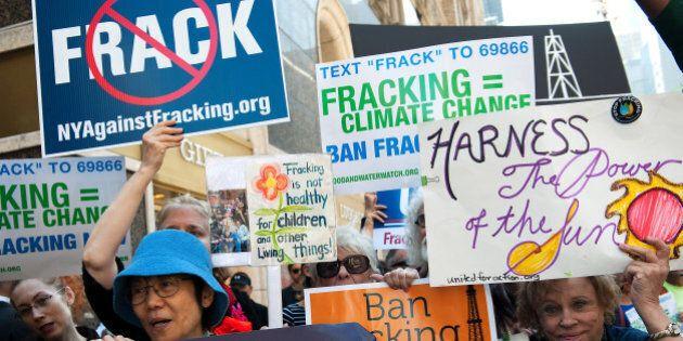 NEW YORK, NY - SEPTEMBER 23: Anti-fracking demonstrators protest on 51st Street and 7th Avenue as President...
