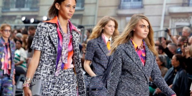 Model Cara Delavingne, right,  and other models wear creations as part of Chanel's Spring/Summer 2015 ready-to-wear fashion collection presented in Paris, France, Tuesday, Sept. 30, 2014. (AP Photo/Thibault Camus)