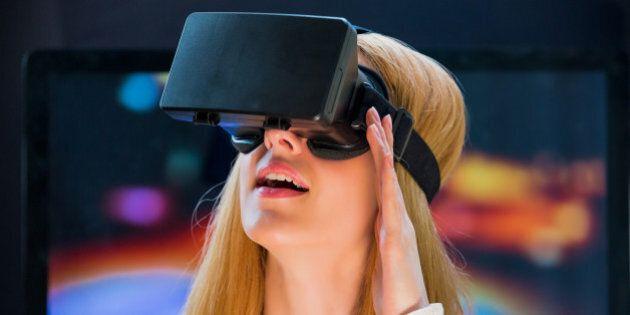 Girl with pleasure uses head-mounted display