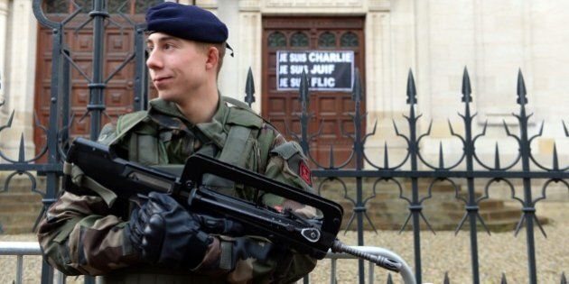 A soldier stands guard outside the main Synagogue in Bordeaux on January 14, 2015. France announced an...