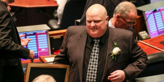 TORONTO, ON- DECEMBER 2 Former Mayor Rob Ford leaves the chambers after Mayor John Tory delivered his...