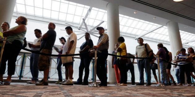 FILE - In this Sept. 3, 2014 photo, people wait in line to sign up for unemployment in Atlantic City,...