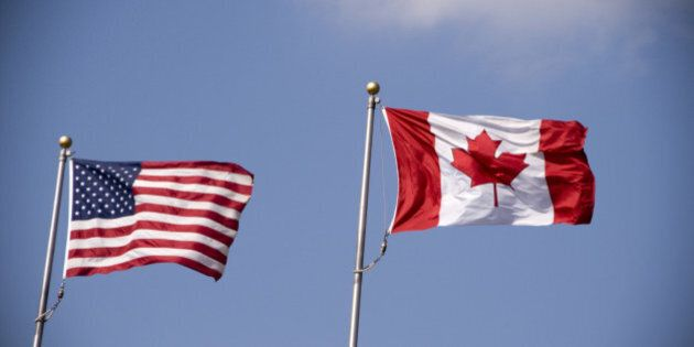American and Canadian flag flying side by