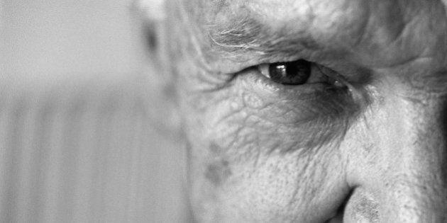 Senior man looking at camera, close-up,