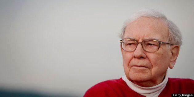 Warren Buffett, chairman of Berkshire Hathaway Inc., listens during an interview on the sidelines of...