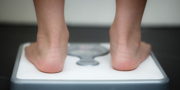 Image denotes weight, health, obesity, eating disorders, obsession.