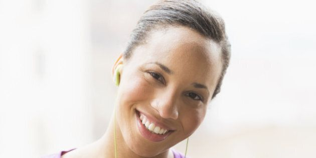 Portrait of female jogger with mp3