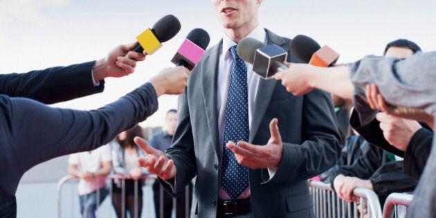 Politician talking into reporters'