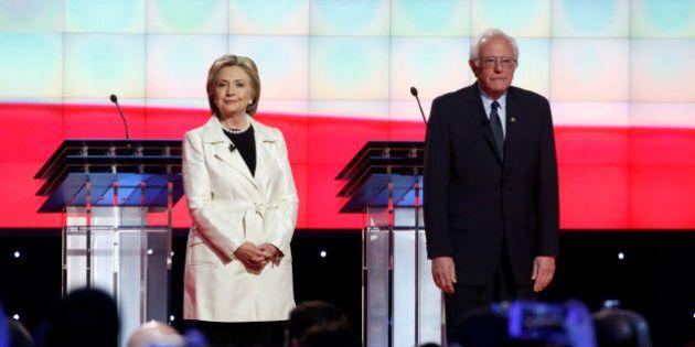 Democratic U.S. presidential candidate Hillary Clinton and Senator Bernie Sanders (R) stand together...