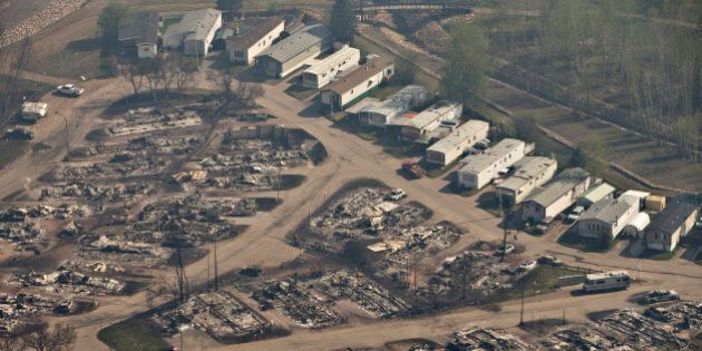 An area devastated by a wildfire is seen in an aerial view in Fort McMurray, Alberta, Canada, May 13,...
