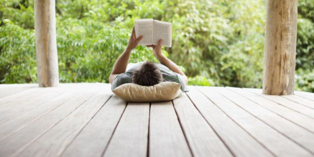 Man reading on porch in remote area