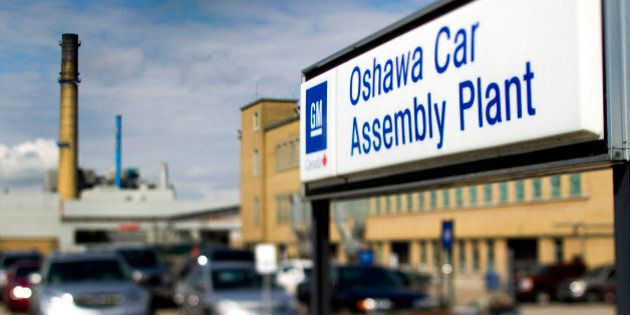 The General Motors Co. (GM) assembly plant stands in this photo taken with a tilt-shift lens in Oshawa,...