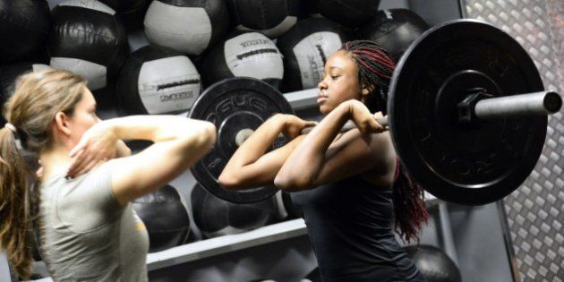 TO GO WITH AFP STORY BY FRANCOISE CHAPTALA woman lifts weight during a crossfit training in a gym in...
