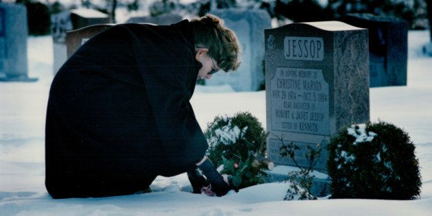 CANADA - FEBRUARY 14: Remembering Christine: Janet Jessop places a single red rose on the grave of her...