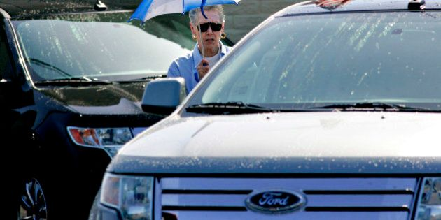 UNITED STATES - APRIL 28: A woman looks over a 2009 Ford Edge on display at Ken Grody Ford in Carlsbad,...