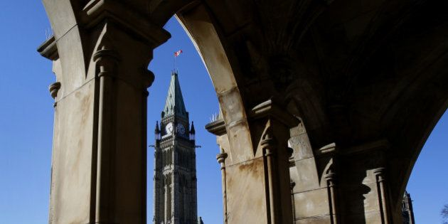 The Centre Block and Peace Tower of Parliament stand on Parliament Hill in Ottawa, Ontario, Canada, on...