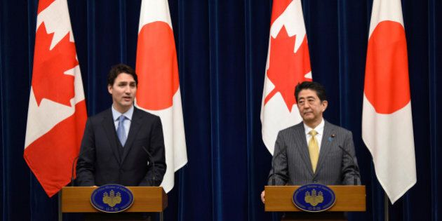 Canadian Prime Minister Justin Trudeau (L) and his Japanese counterpart Shinzo Abe attend their joint...