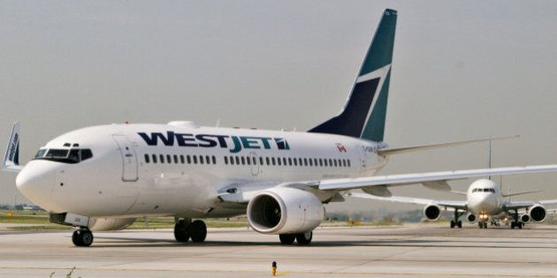 CANADA - JUNE 08:  A WestJet plane taxi's on the runway of Pearson International Airport in Toronto, Ontario, Canada, Wednesday, June 8, 2005.  (Photo by Norm Betts/Bloomberg via Getty Images)