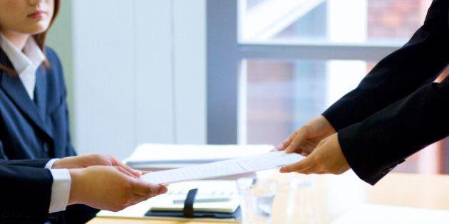 Businesswoman handing over