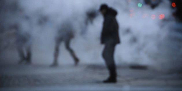 man crossing steam on downtown toronto