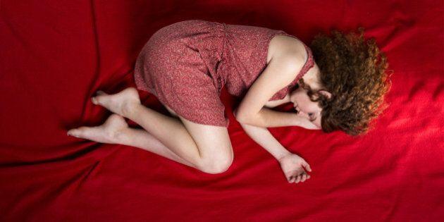 beautiful sad woman is lying on