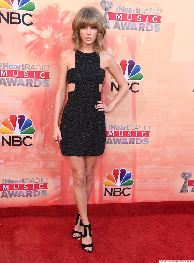 Taylor Swift Sizzles In Sparkly Black Dress At iHeartRadio Music