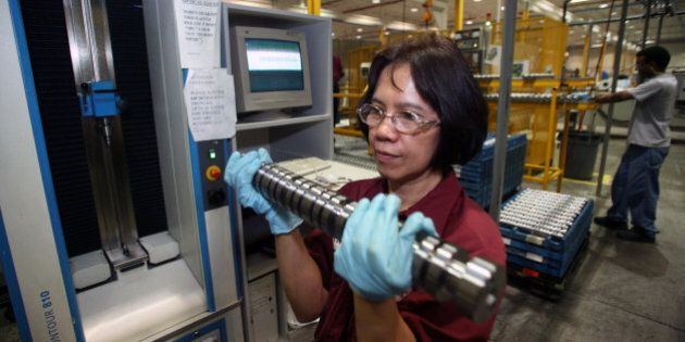 CANADA - MAY 12: Conchita Villena removes, for measurment and testing, a camshaft for General Motors'...