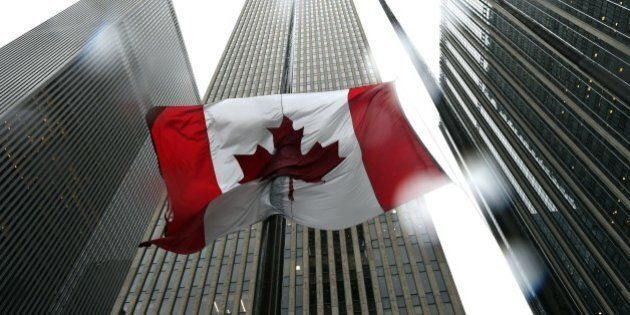 The Canadian flag flies at half-mast at the Consulate General of Canada in New York October 23, 2014.  Canada's Prime Minister Stephen Harper vowed the country would 'not be intimidated' after a reported Muslim convert stormed parliament and killed a soldier on October 22 in Ottawa.  AFP PHOTO / Timothy A. Clary        (Photo credit should read TIMOTHY A. CLARY/AFP/Getty Images)