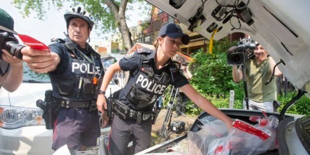 TORONTO, ON - MAY 26 - Police remove Marijuana products from Cannawide dispensary in Kensington Market on May 26, 2016. (Carlos Osorio/Toronto Star via Getty Images)