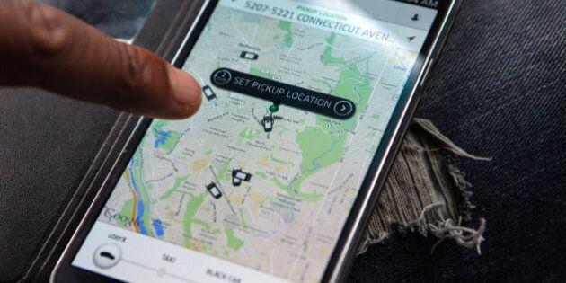 WASHINGTON, DC - APR 4: UberX driver, Michael Belet, checks the Uber customer app to see where other...