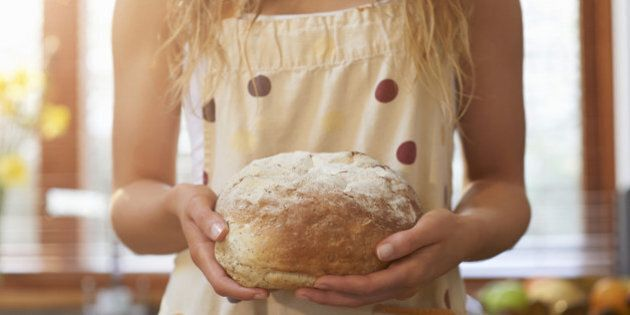 Woman holding freshly baked